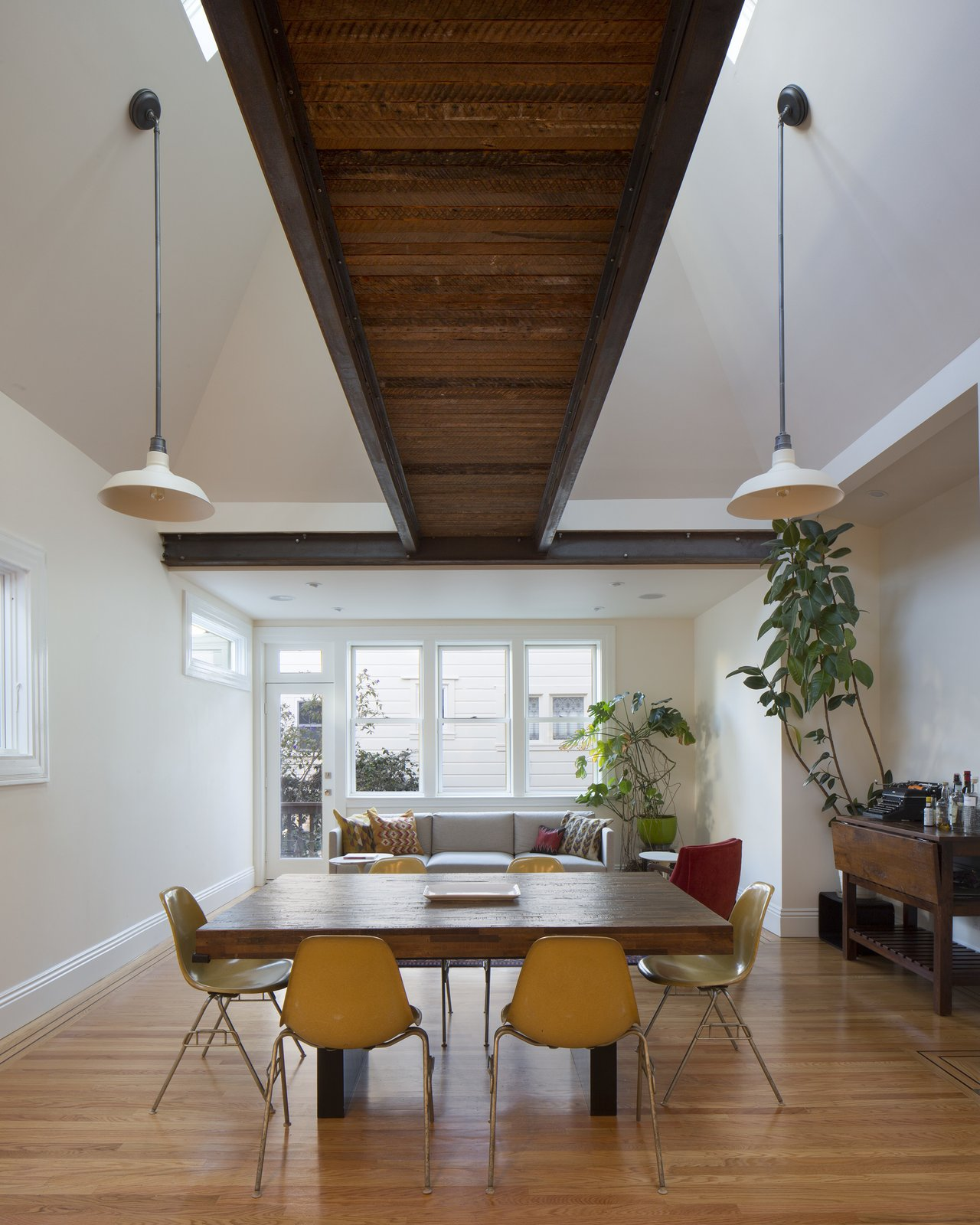 Living Room, Pendant Lighting, Sofa, Recessed Lighting, and Light Hardwood Floor view toward living area at rear of room  Bridge House by McElroy Architecture