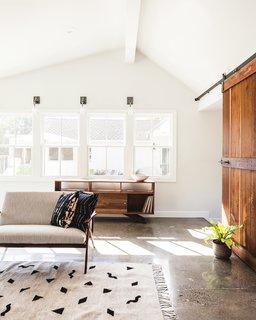family room with barn door