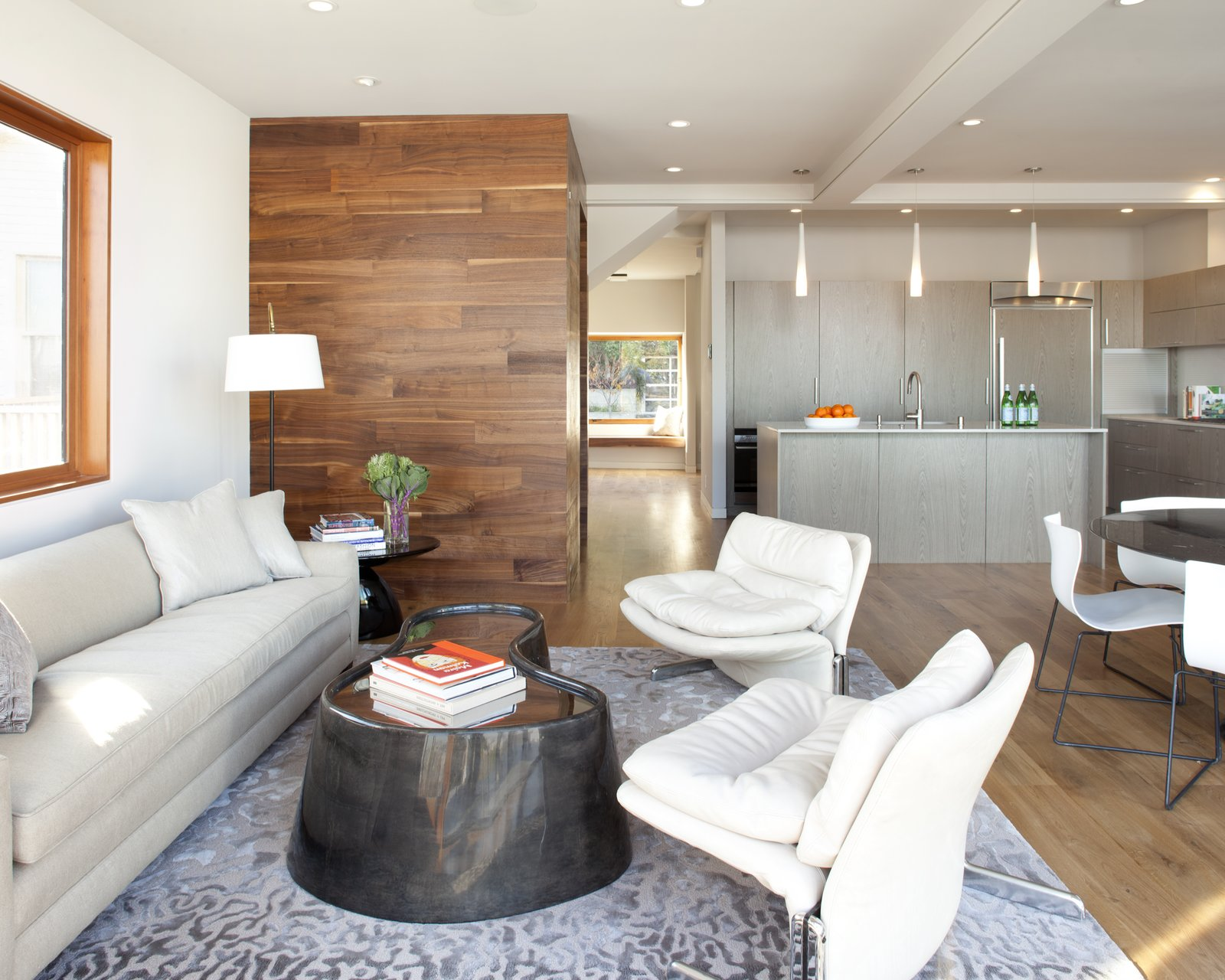 Living Room, Chair, Light Hardwood Floor, Sofa, and Accent Lighting walnut wall cladding quantum windows  Bungalow Update by McElroy Architecture