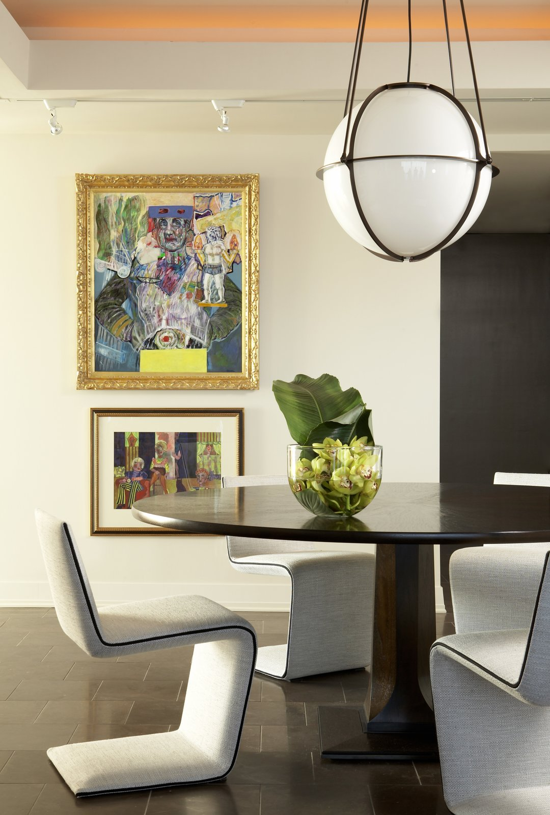 Mark Williams designed this Plaza Towers dining space with lots of light and art. The Globe Pendant is by Boyd Lighting.  60+ Modern Lighting Solutions by Dwell from Delicious Dining Room Lighting