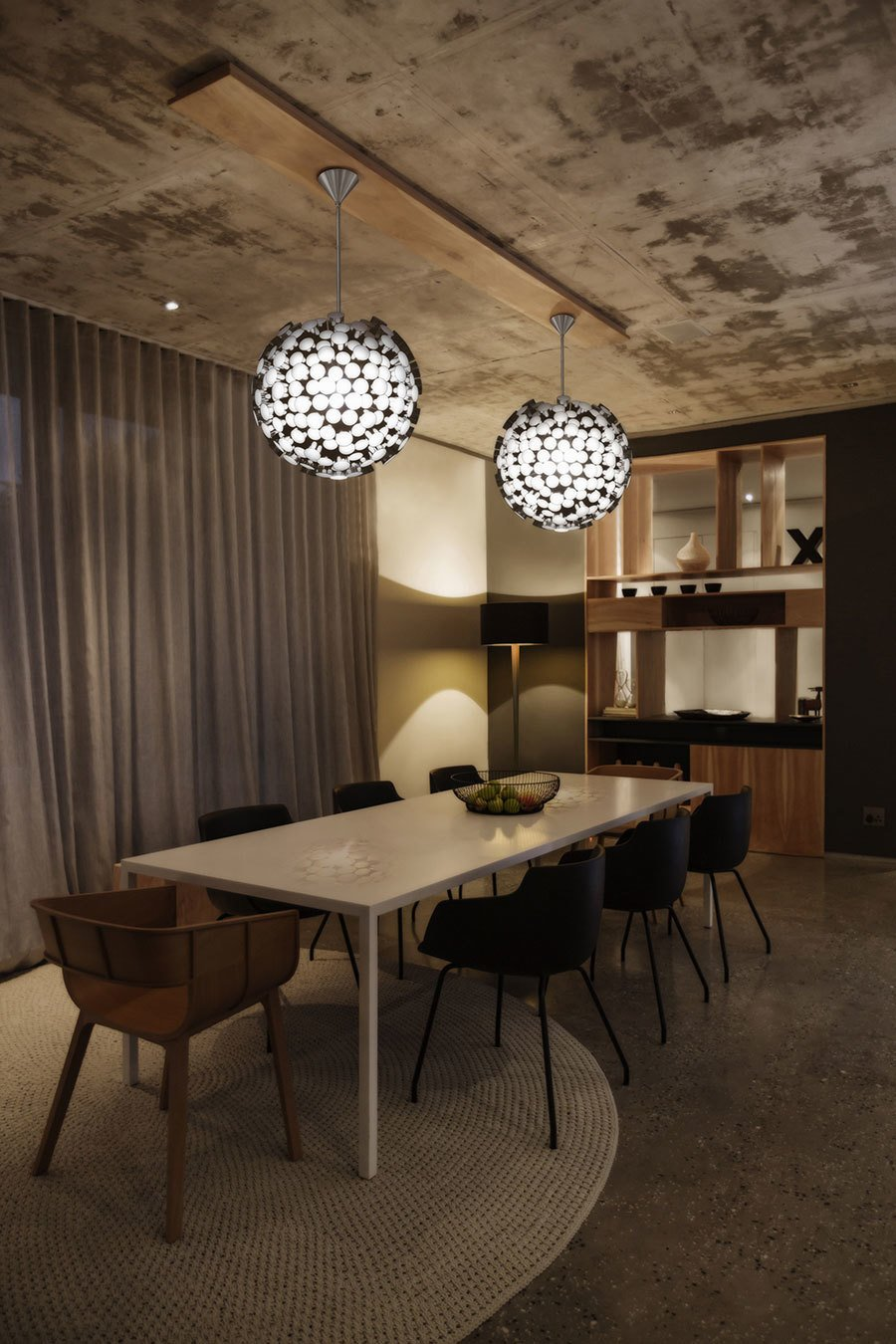 What once was a warehouse is now a luxury condo. This dining room features a pair of Asteroid Pendants.  Delicious Dining Room Lighting