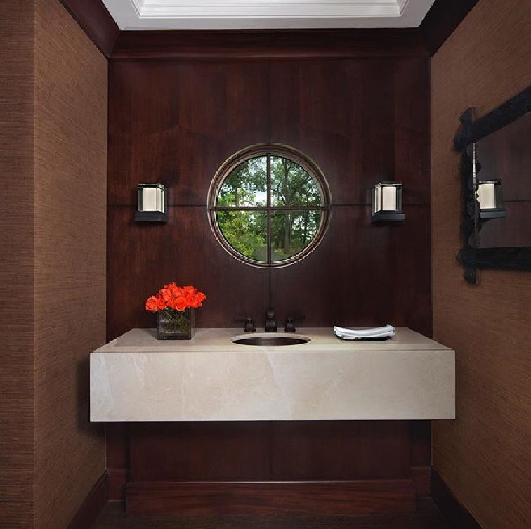 Designed by Christine and Jacques Rouviere for Boyd Lighting, the LED Glow Sconce has the look of an elegant ice cube perched on a ledge. In a dark room it is a virtual beacon. Available in two metal finish options. Dimmable. Interior design by Carrie Long Interiors. Photo by Beth Singer. #sconce #bathroomsconce #lighting #modernlighting #bathroomlighting  Boyd Lighting Freshens Up Bathrooms