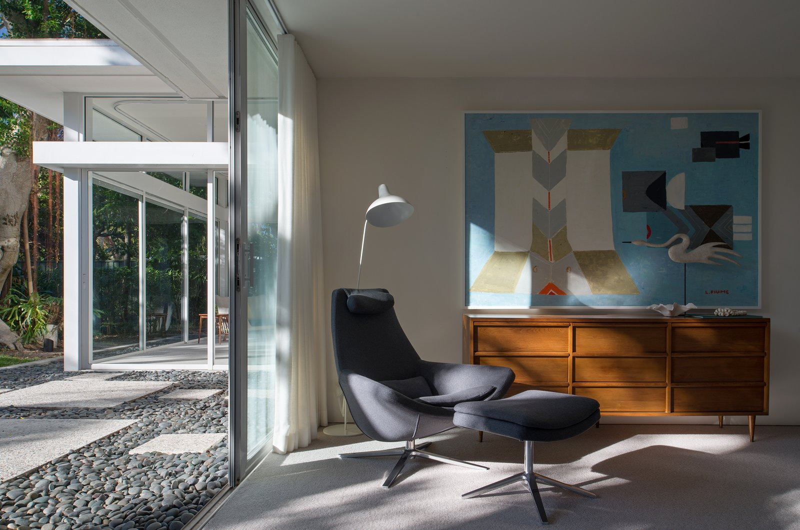 The architectural details of the home present dramatic shadows and highlights that evolve and dissolve throughout the day.  The Pavilion House by Seamus Payne