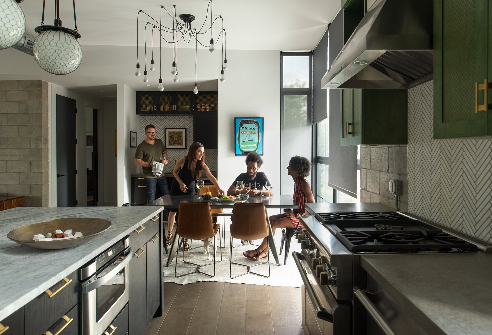 Kitchen, Concrete, Marble, Dark Hardwood, Subway Tile, Concrete, Wood, Pendant, Ceiling, Range, and Range Hood Architect Tobin Green and his wife, Bianca, entertain regularly at 400SOLA. It's an important part of their lifestyle, and thus, an important part of Green's design.  Best Kitchen Range Concrete Concrete Photos from 400SOLA