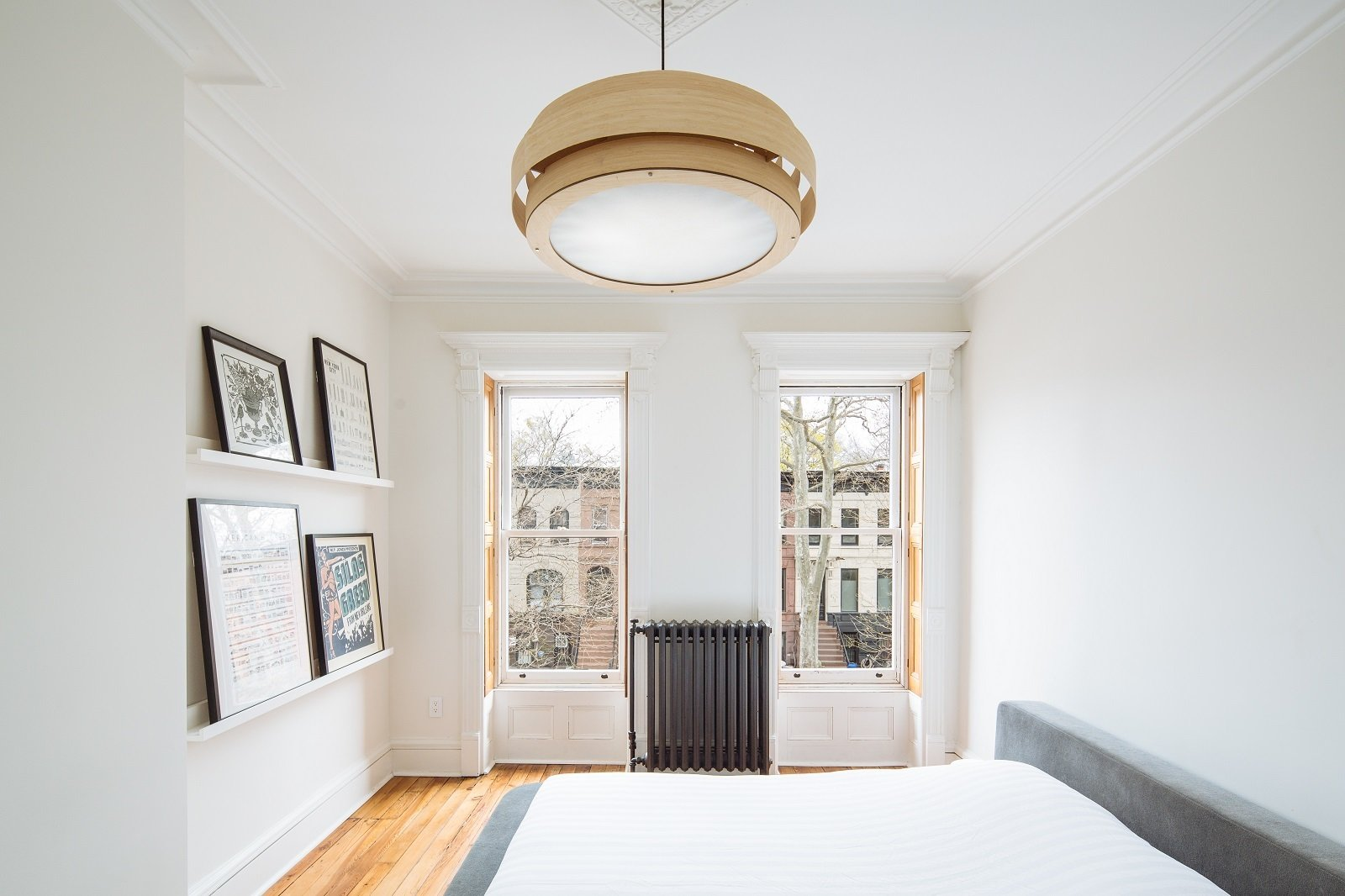 Bedroom, Pendant Lighting, Accent Lighting, Bed, and Medium Hardwood Floor Masterbedroom  Brooklyn Brownstone by Sonya Lee Architect llc