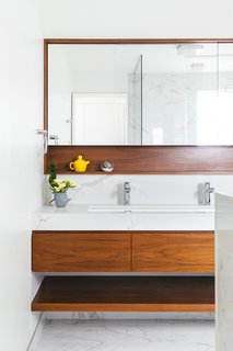Masterbathroom with custom walnut vanity and medicine cabinet niche