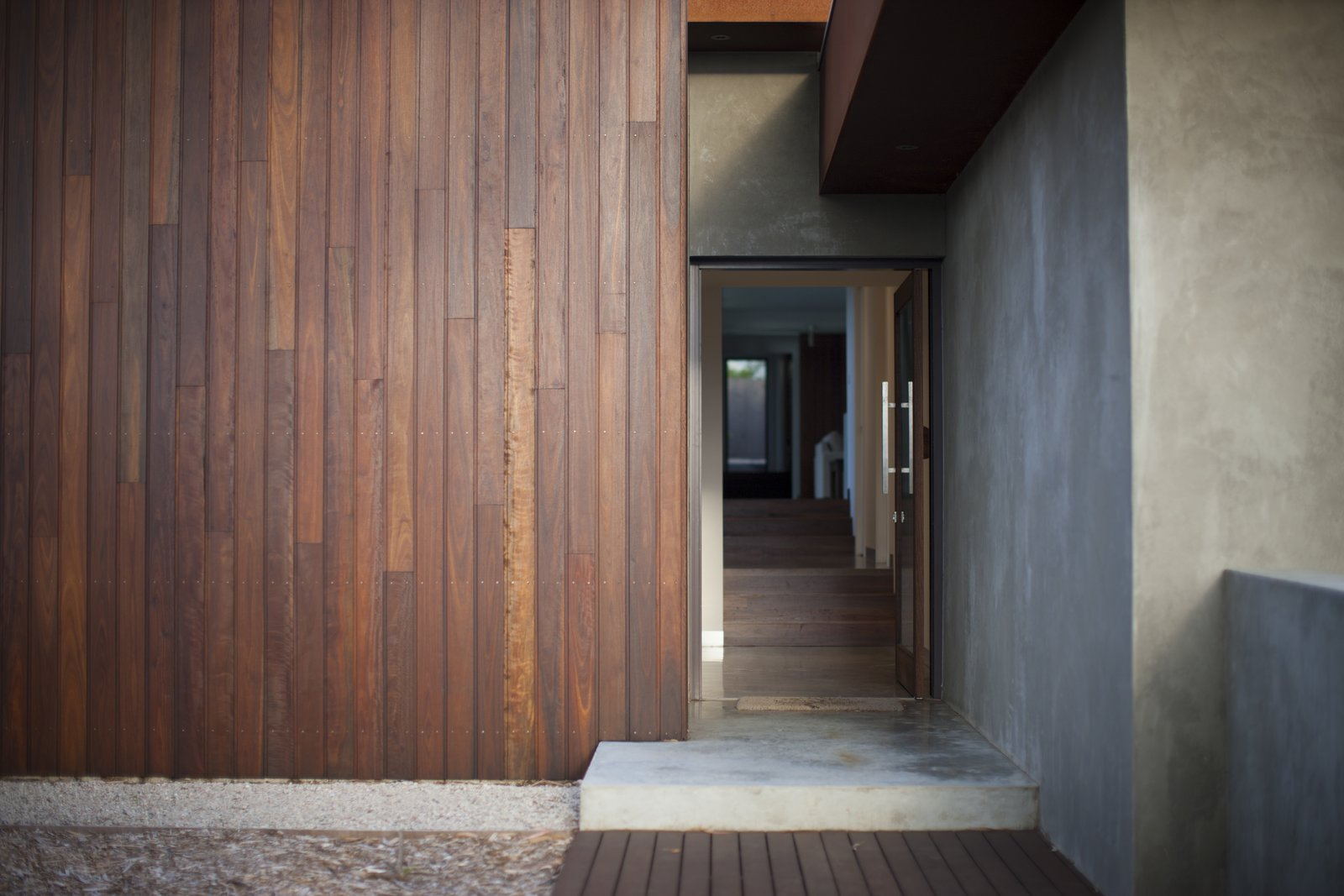 Entry Showing Internal Spotted Gum Stairs  Pod Residence by Bespoke Architects