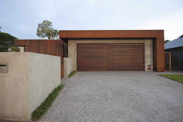 Spotted Gum Garage Doors and Coreten Eyelash  Pod Residence by Bespoke Architects