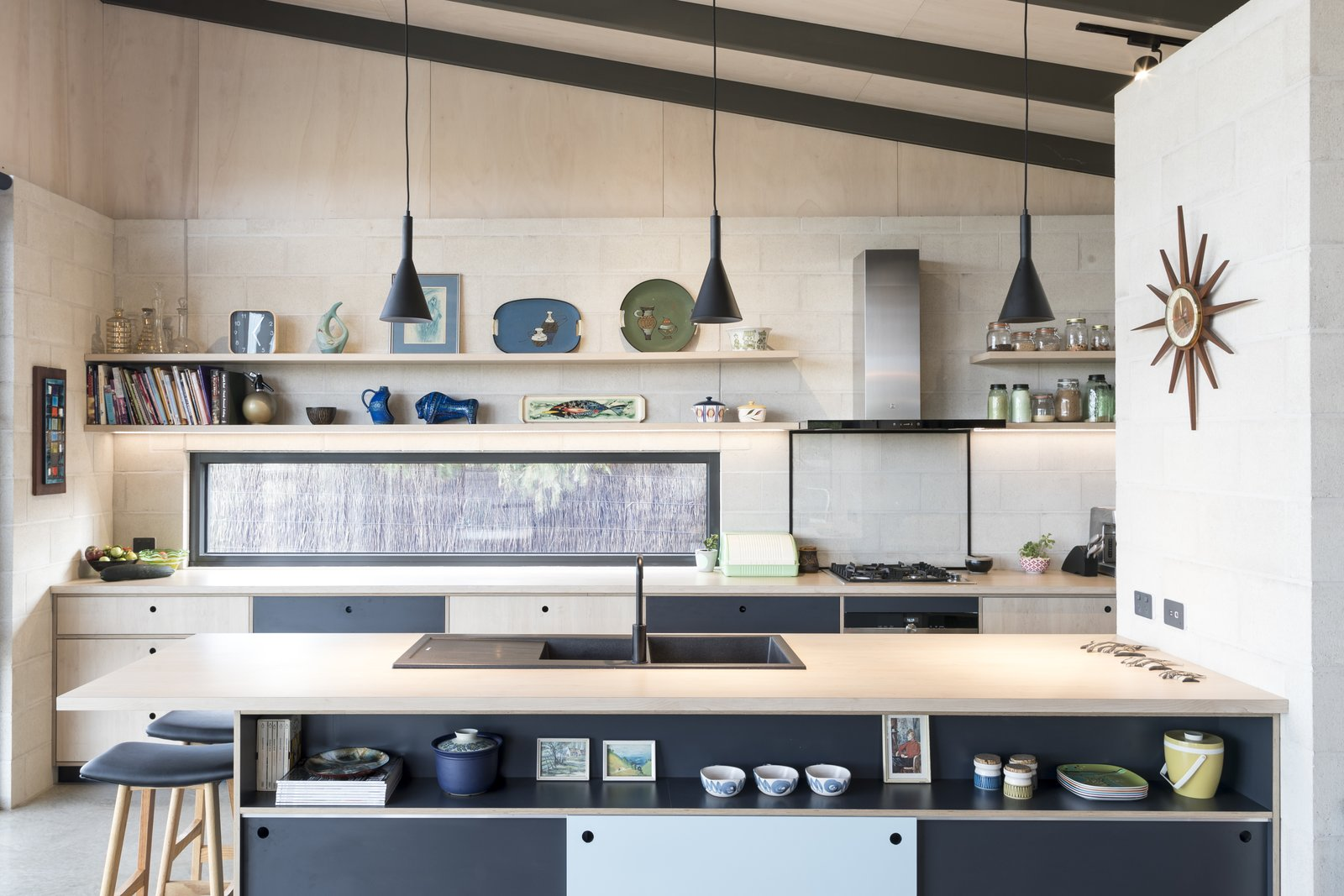 Kitchen, Ceiling Lighting, Laminate Counter, Cooktops, Concrete Floor, Pendant Lighting, Laminate Cabinet, Track Lighting, Drop In Sink, Range, and Brick Backsplashe Kitchen  The Golf Course House by Bespoke Architects
