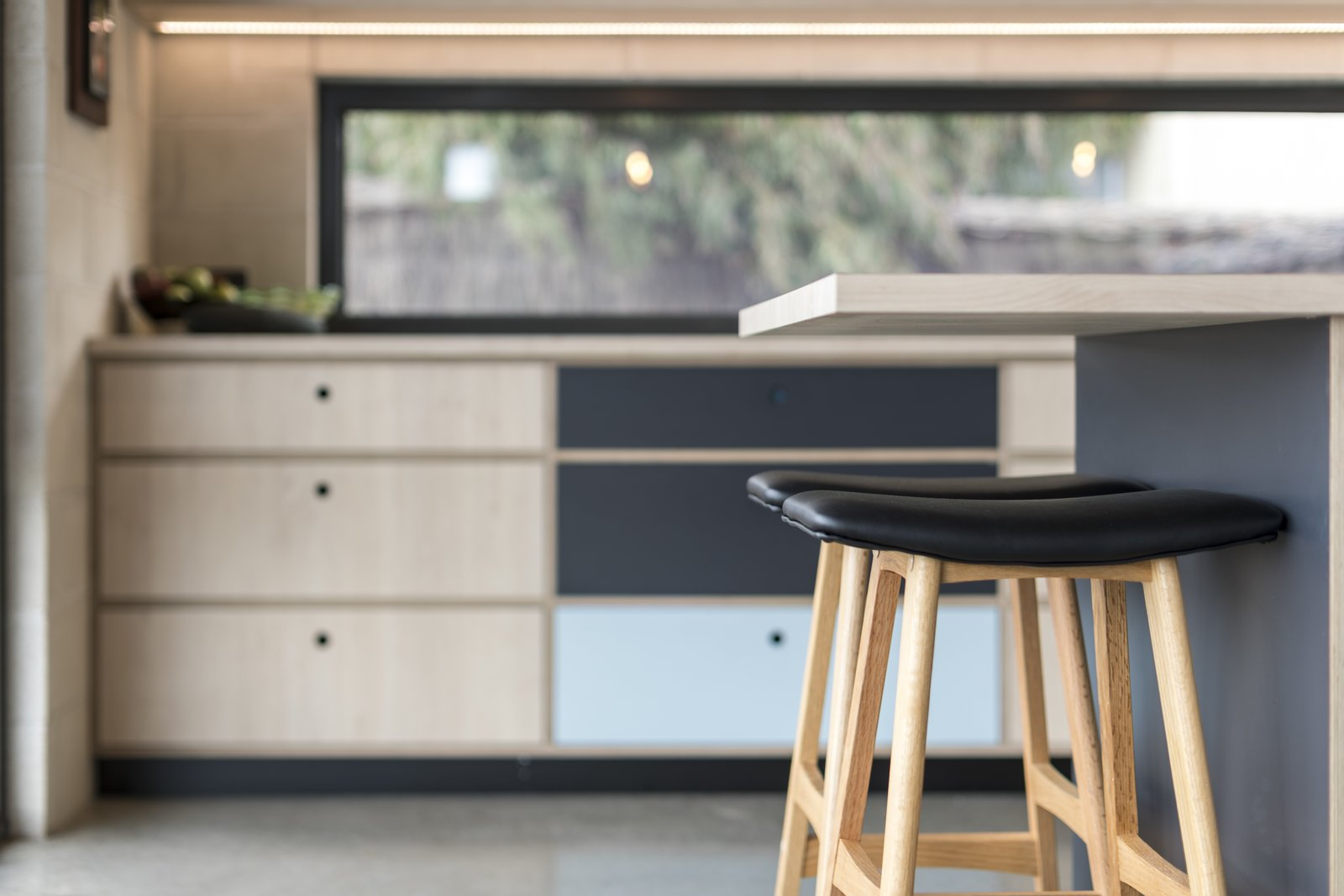 Kitchen, Laminate Cabinet, Brick Backsplashe, Laminate Counter, and Concrete Floor Kitchen bench   The Golf Course House by Bespoke Architects