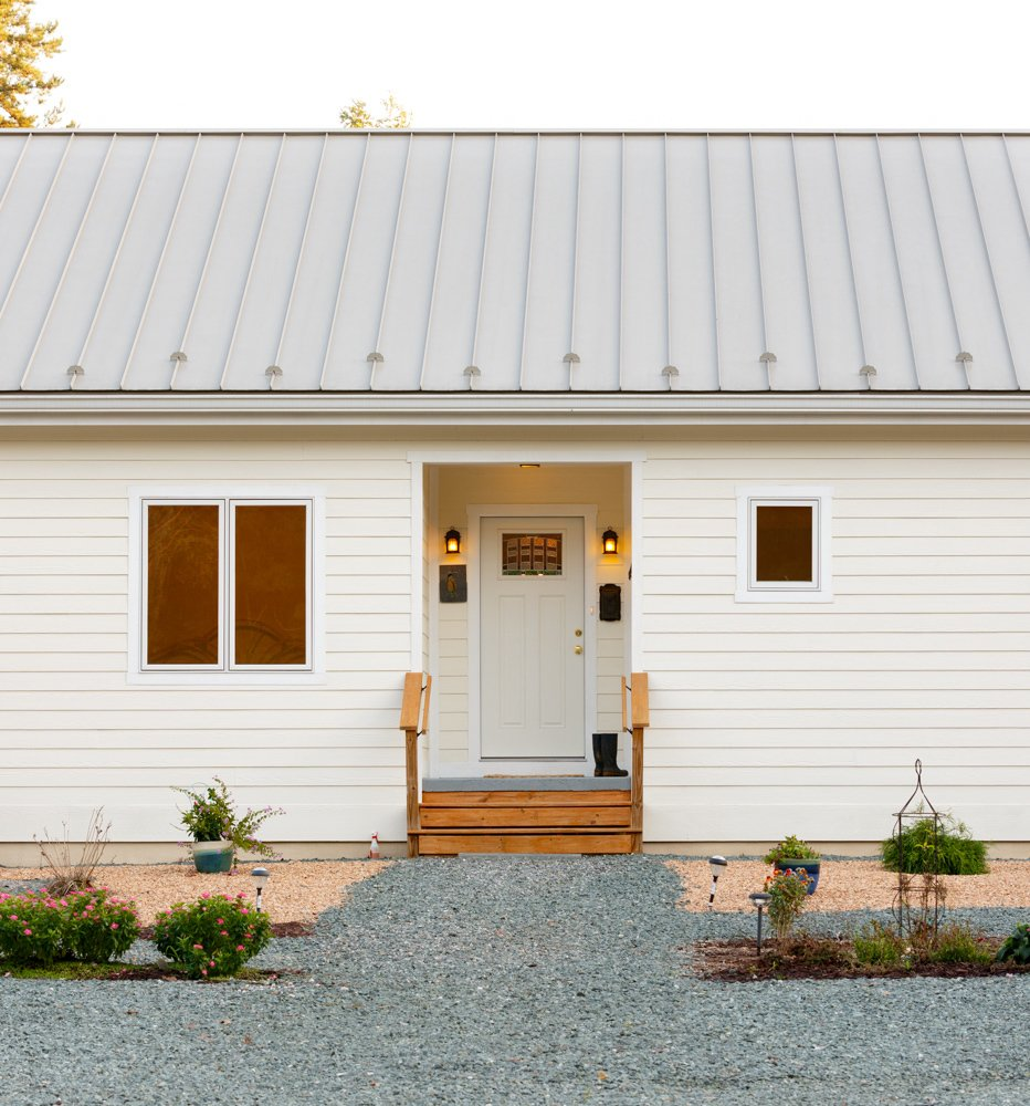 Prefabricated net-zero home by Deltec Homes #deltechomes #prefab #netzero #entrance  Net-Zero Prefab Home by Deltec Homes