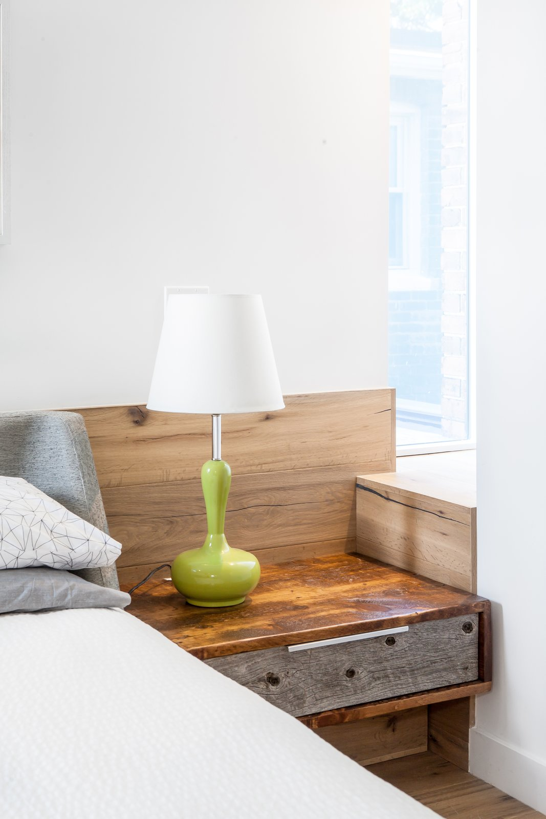 Bedroom, Bed, Night Stands, Lamps, Accent, Table, Light Hardwood, and Medium Hardwood Detail at bedside with window nook  Best Bedroom Accent Bed Table Medium Hardwood Photos from House Grace