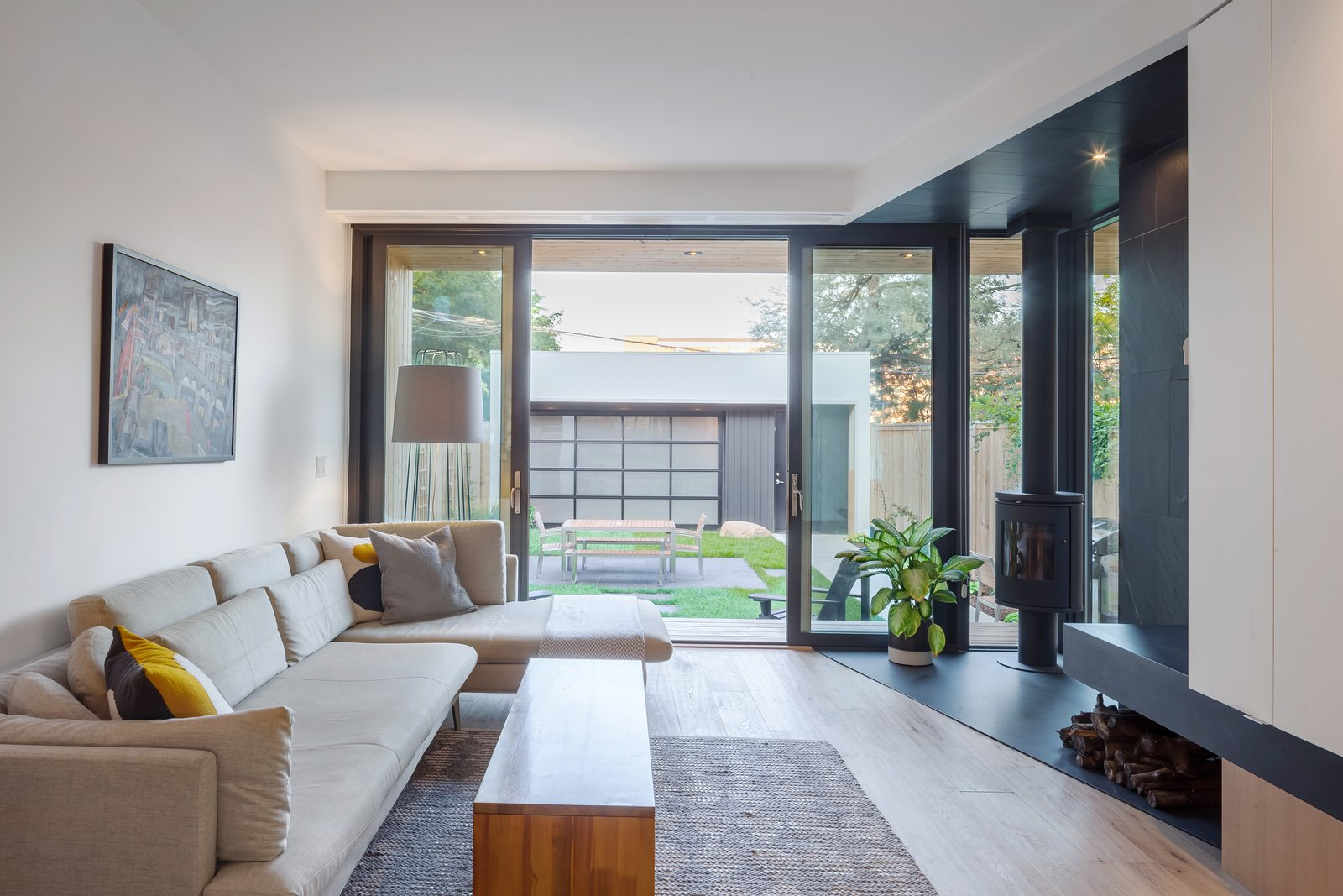 Living, Sofa, Sectional, Coffee Tables, Accent, Wood Burning, Corner, Slate, Medium Hardwood, and Light Hardwood Living room opening out onto rear garden  Living Sofa Medium Hardwood Slate Photos from House Grace