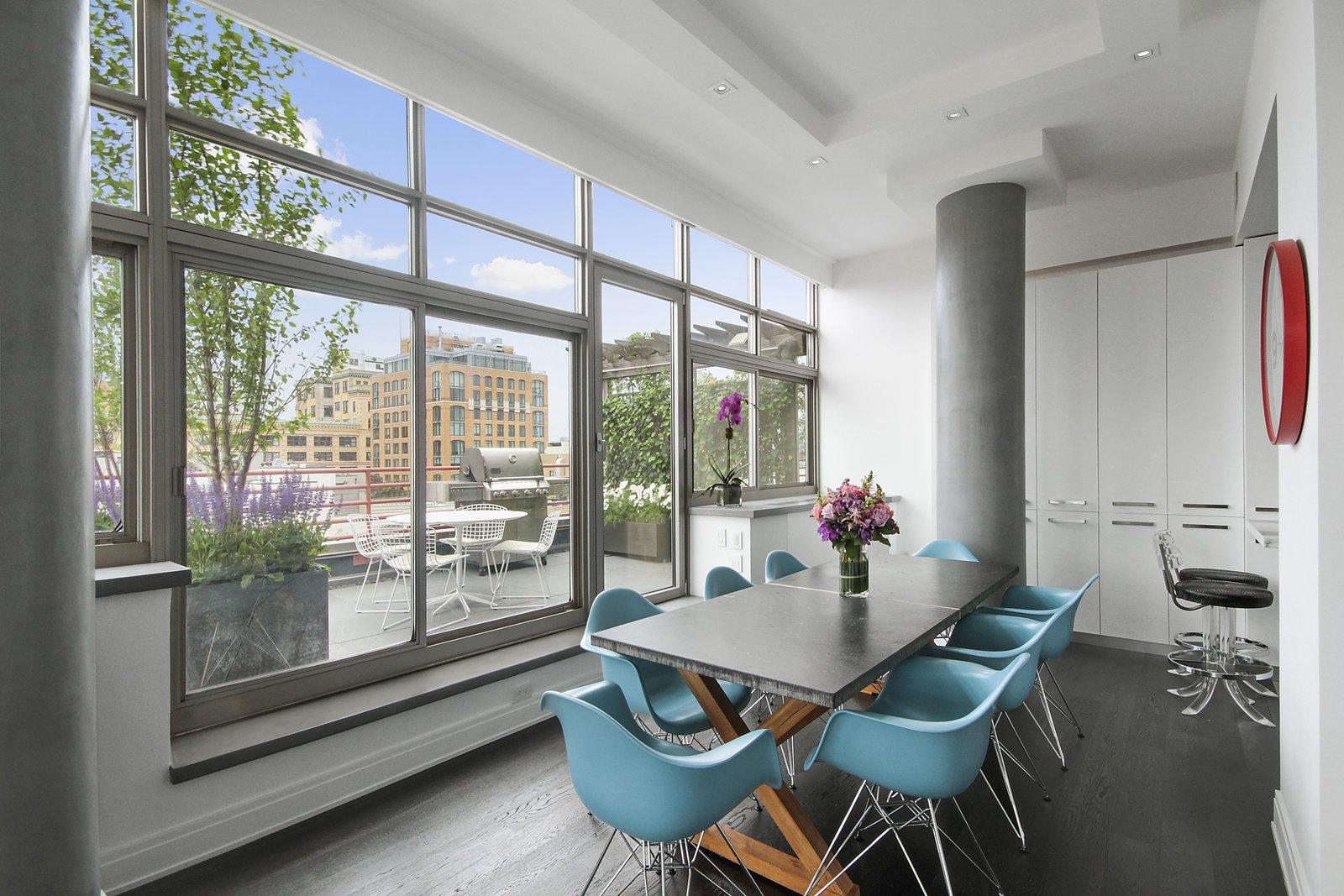 Dining Room, Chair, Recessed Lighting, Stools, Dark Hardwood Floor, and Table West Village Terrace  Eames Molded Chairs from West Village Terrace
