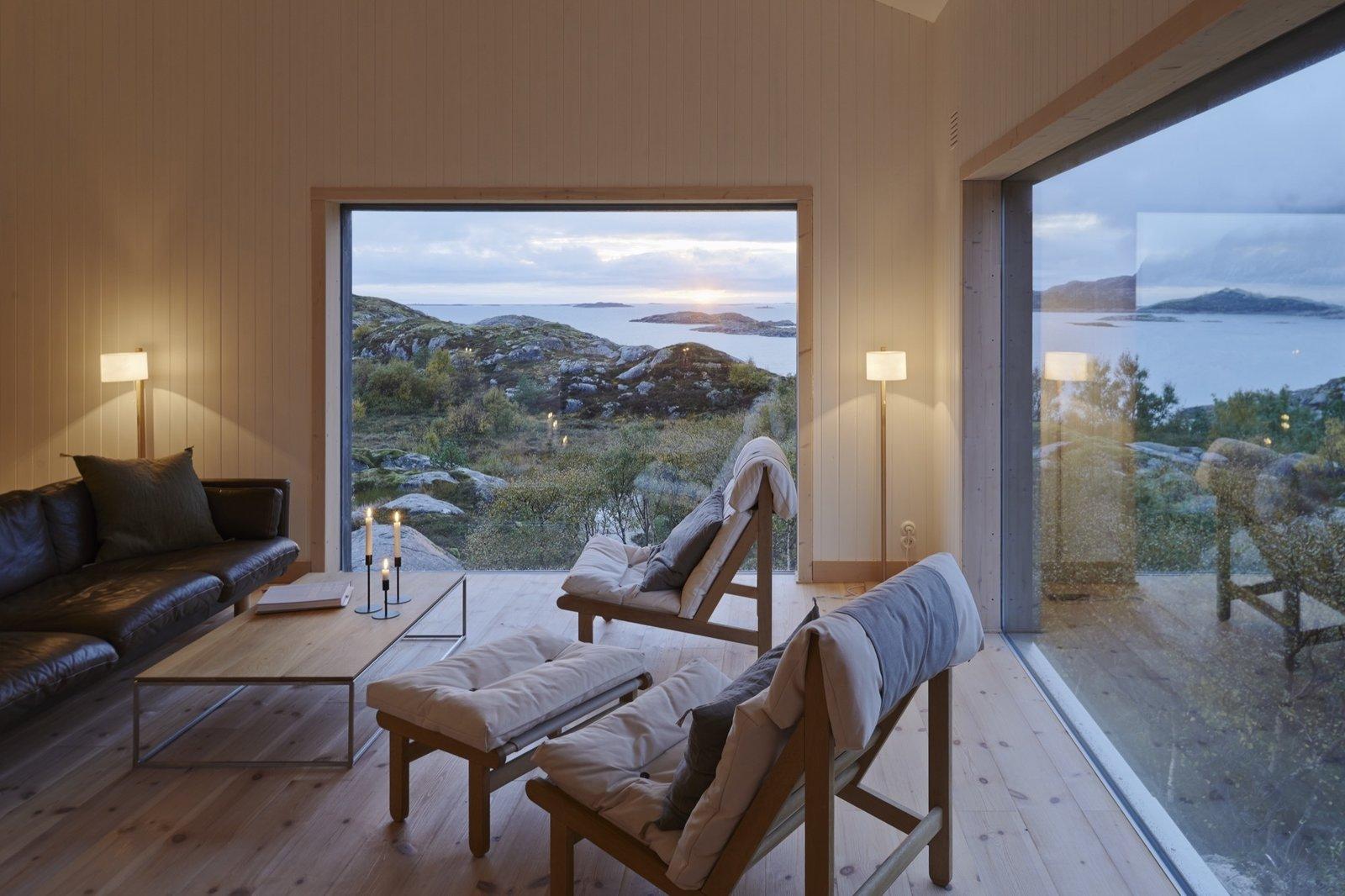 Living Room, Coffee Tables, Chair, Light Hardwood Floor, and Sofa Vega Norge, Erik Kolman Janush  Photo 6 of 14 in Naked Naust