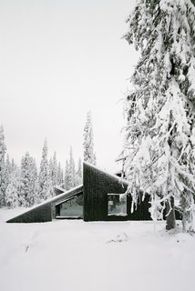 The concept of this Scandinavian getaway was simple: to create a cabin that's small and sparse, yet spatially rich. The 592-square-foot cabin, commissioned by a private client and completed in 2016, comprises a large living room, bedroom, ski room, and small annex with a utility room. It functions off the water and electricity grids.