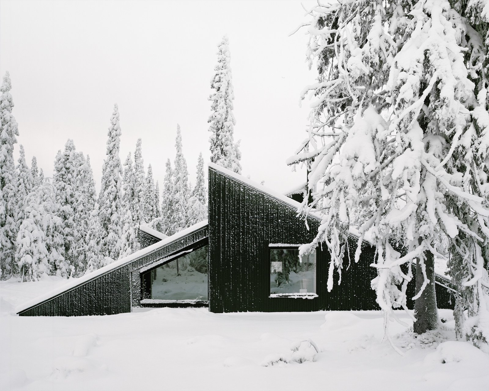 Exterior, Shed RoofLine, House Building Type, Metal Roof Material, and Wood Siding Material The cabin's concept was simple: To create a cabin that is small and sparse yet spatially rich. The 55-square-meter (592-square-foot) cabin, commissioned by a private client and completed in 2016, comprises a large living room, bedroom, ski room, and small annex with a utility room. It functions off the water and electricity grids.
