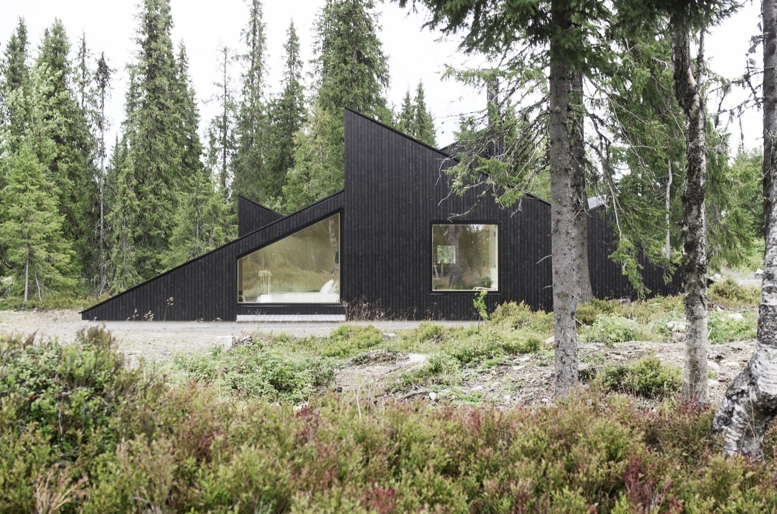 Outdoor The concept of this Scandinavian getaway was simple: To create a cabin that is small and sparse yet spatially rich. The 55-quare-meter (592-square-foot) cabin, commissioned by a private client and completed in 2016, comprises a large living room, bedroom, ski room, and small annex with a utility room. It functions off the water and electricity grids.  Photo 11 of 18 in The Vindheim Cabin: Snowbound in Norway