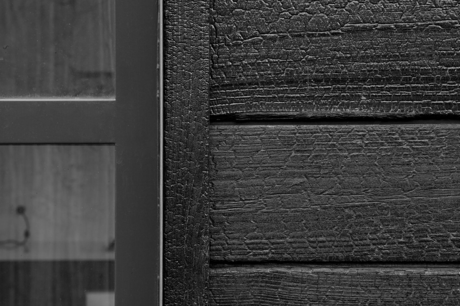 Charred cedar wood gives the cottage's exterior a rough, bark-like texture  Photo 6 of 13 in Retreat in the Aspen Grove