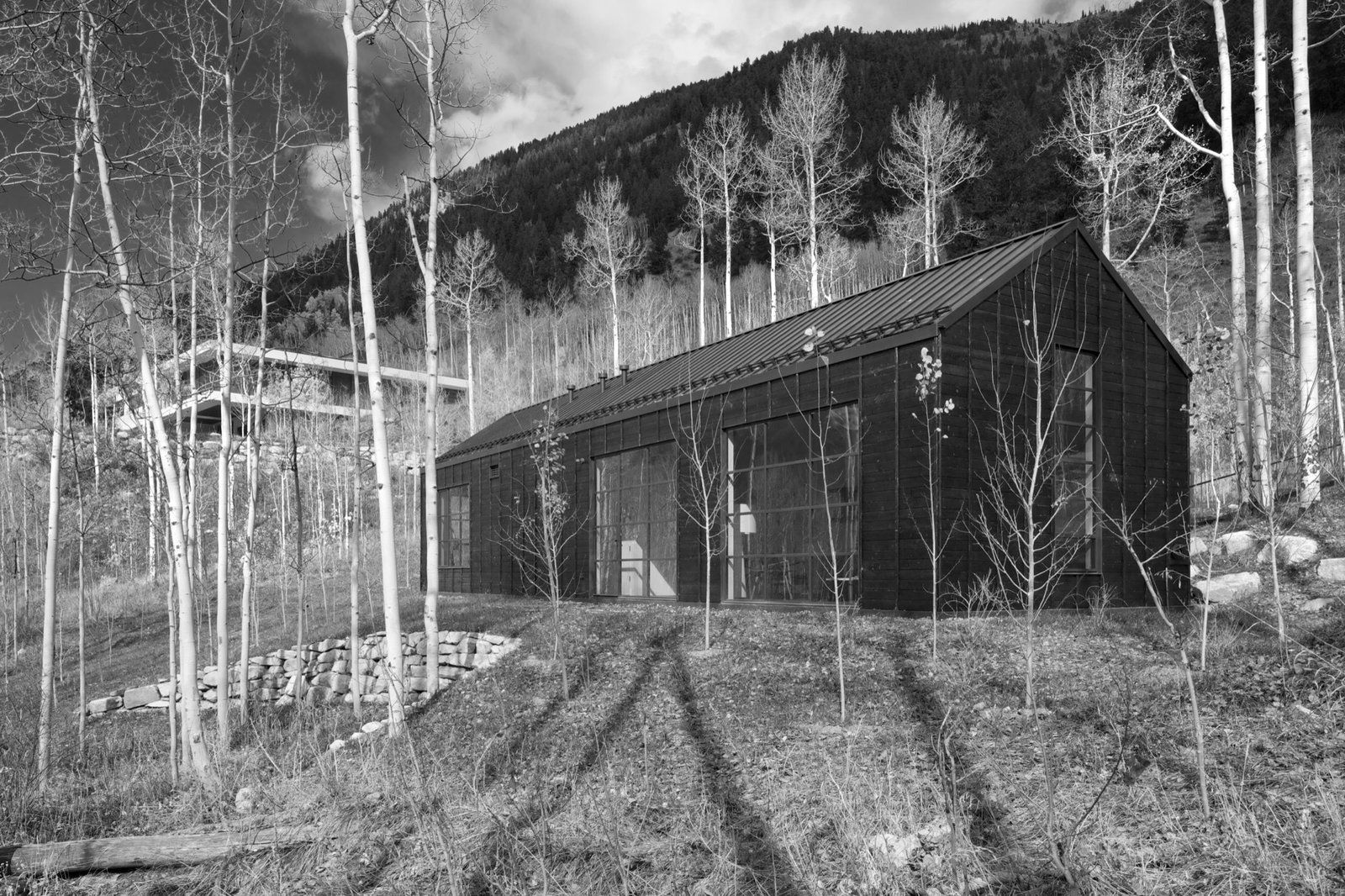 Cottage Black in nestled in the aspen grove below the main house.  Photo 2 of 13 in Retreat in the Aspen Grove