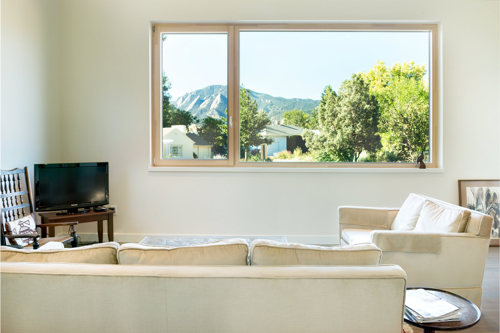 Zola Tilt & Turn and Fixed Window - Zola Thermo Clad  Tilt & Turn windows can be very large, with each sash up to five and a half feet wide. Zola Tilt & Turn windows have a multi-point locking mechanism providing safety and superb air sealing.  Sunset