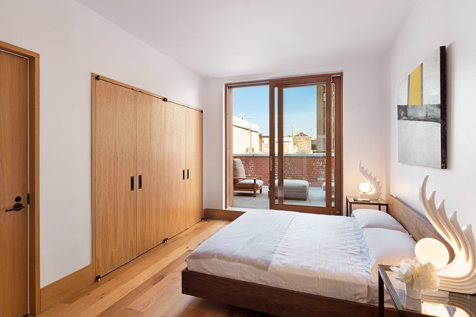Zola Lift & Slide Door offering outstanding thermal and acoustic performance while showcasing expansive views of downtown Manhattan.  An Historic TriBeCa Building Reborn