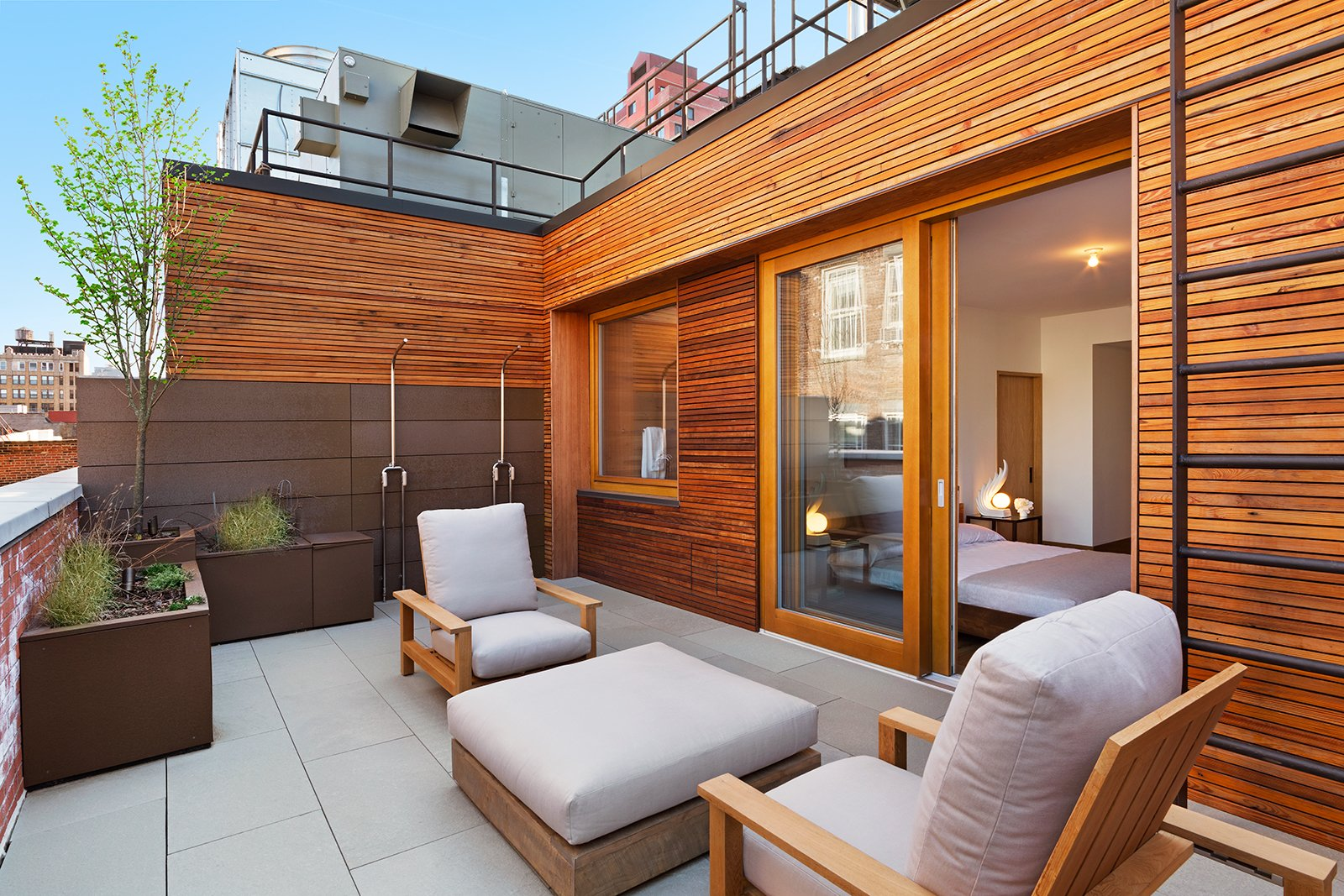 Outdoor Deck features Zola Lift & Slide Door offering outstanding thermal and acoustic performance while showcasing expansive views of downtown Manhattan.  An Historic TriBeCa Building Reborn