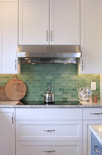 "At this Passive House-certified home in Oregon, the kitchen backsplash is composed of 2"" x 4"" subway tile in Meadow Green, which brings a sense of warmth and personality through the varied tones of soft green. If you're on a budget, subway tile is a great idea for a backsplash because it comes in a range of colors and sizes to suite a range of prices."