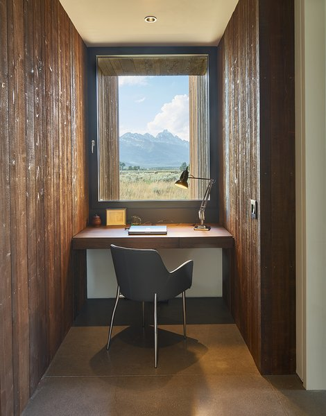 Custom built-in office desk are fabricated from a mixture of walnut, mimicking the same hue as the façade's Douglas fir. The homeowners' son-in-law, Alex Everett handcrafted many of the custom pieces.