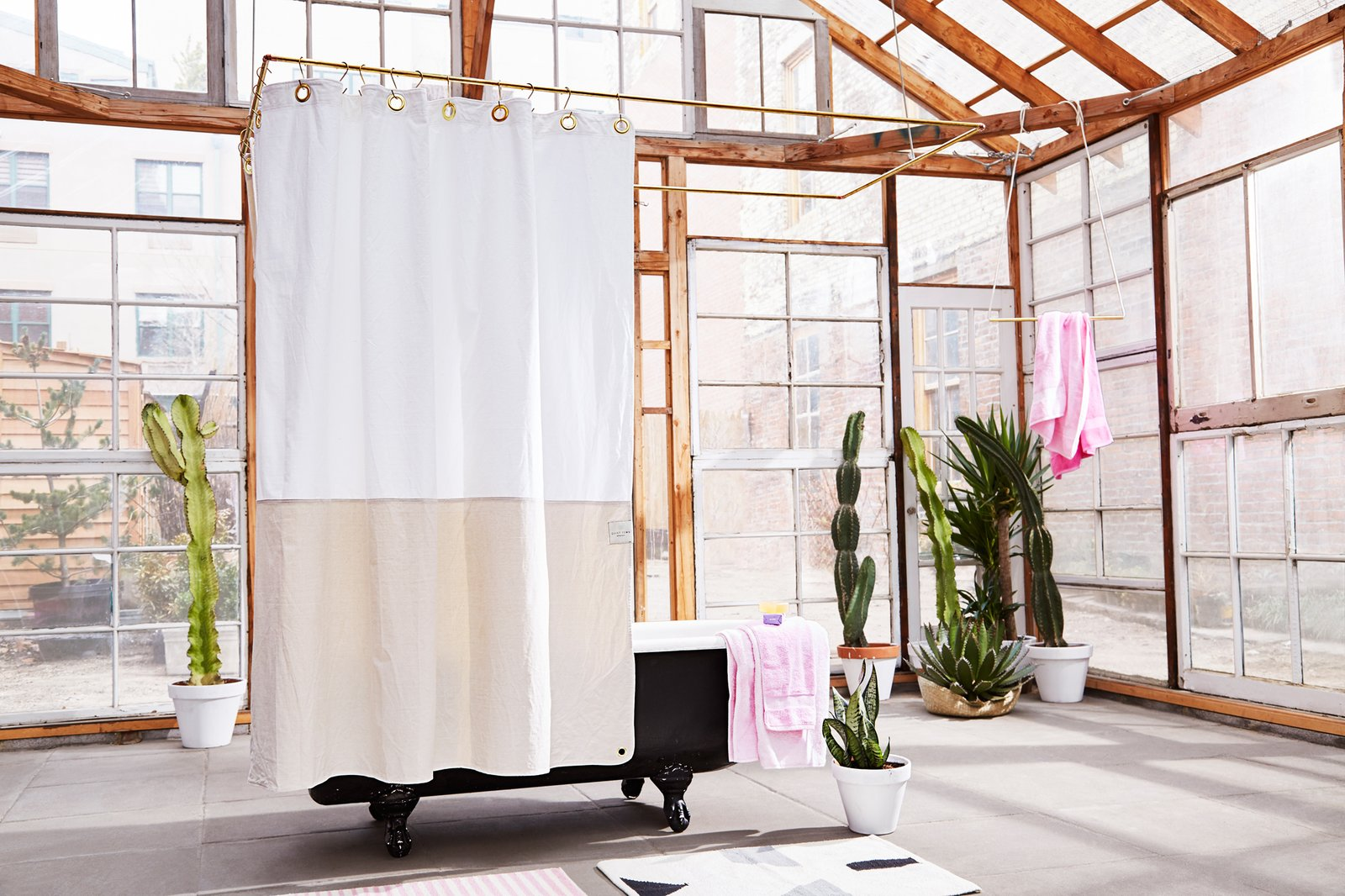 The Orient--Sand  This 100% GOTS certified organic cotton canvas curtain is inspired by a simple horizon line. We constructed it using denim hemming on the interior and exterior for a super-clean finish no matter what side of the curtain you're on. The corners are rounded like an old-fashioned, canvas sail.  Bathroom from Debut Spring 2016 Collection