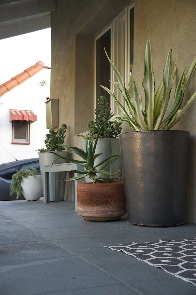 Clean modern planters mix well with vintage terra-cotta on the front porch.  20+ Ways to Design with Planters by Allie Weiss from Potted Garden in Atwater Village