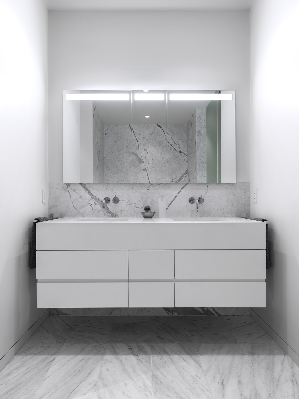 Custom vanity with solid surface counter-top and fascia at the Master Bathroom. The recessed medicine cabinet with integral lighting is by Sidler.  Telegraph Hill Periscope by Samaha+Hart Architecture