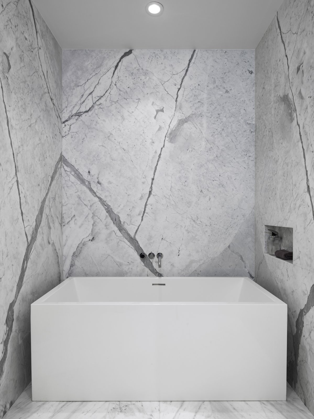 Soaking tub by Wet Style and custom stone niche at the Master Bathroom.  Telegraph Hill Periscope by Samaha+Hart Architecture