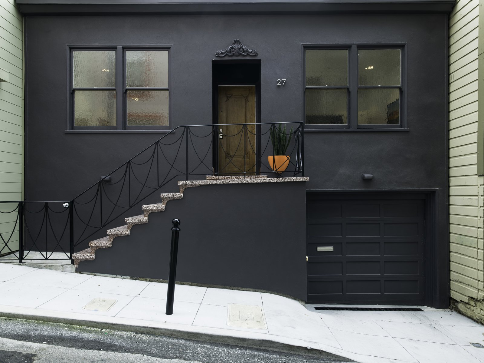 The historic front facade (Alley view) of the house which was preserved and restored. The Sun Room addition at the rear is not visible from the Alley.  Telegraph Hill Periscope by Samaha+Hart Architecture