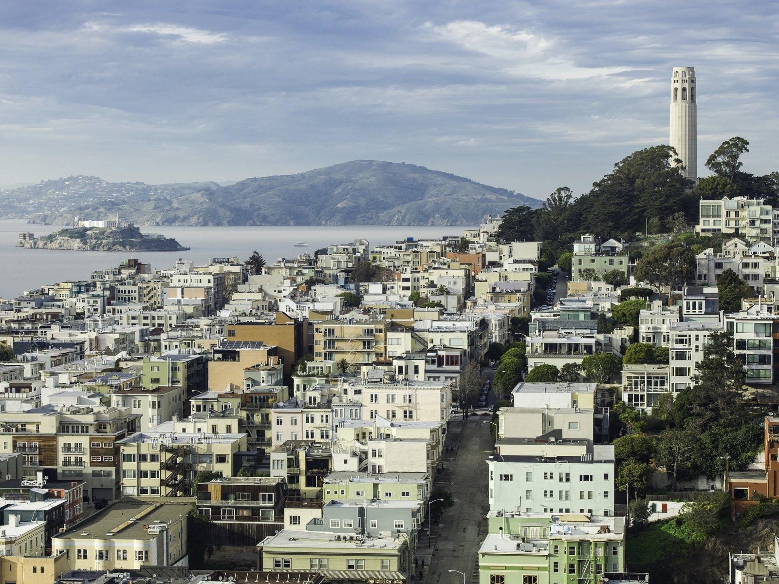View of the project and Telegraph Hill, with Coit Tower and Alcatraz Island beyond.  Telegraph Hill Periscope by Samaha+Hart Architecture