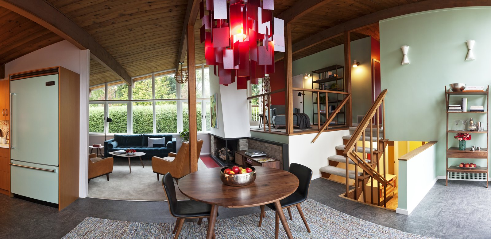 Natural cedar planks on the ceiling and posts throughout the main floor create direction for the eye and further evoke the interplay of the indoors and outdoors in the classic mid-century style of the home.  Photo 5 of 7 in Styling a Rescued Mid-Century Gem
