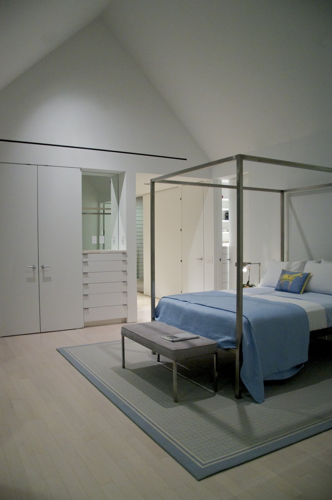 Bedroom, Bed, Bench, Light Hardwood Floor, and Storage interior, bedroom  The Birdhouse by Centric General Contractors