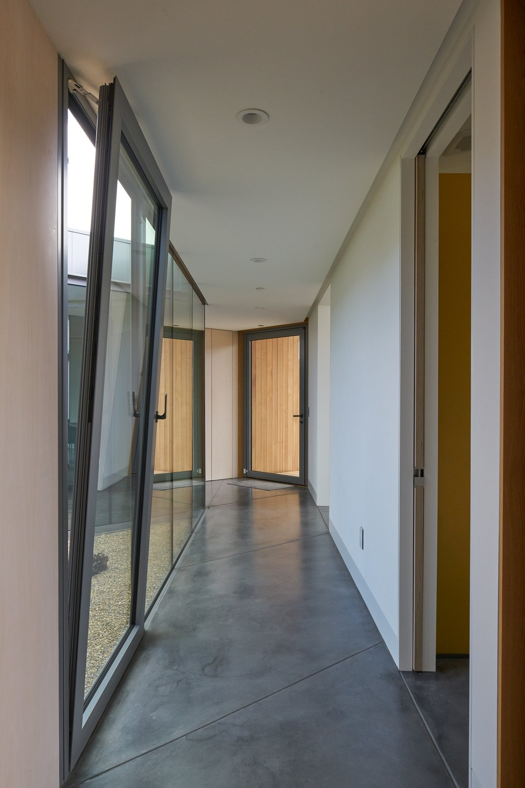 Hallway interior, transitional space  Lake Berryessa Custom Home by Centric General Contractors