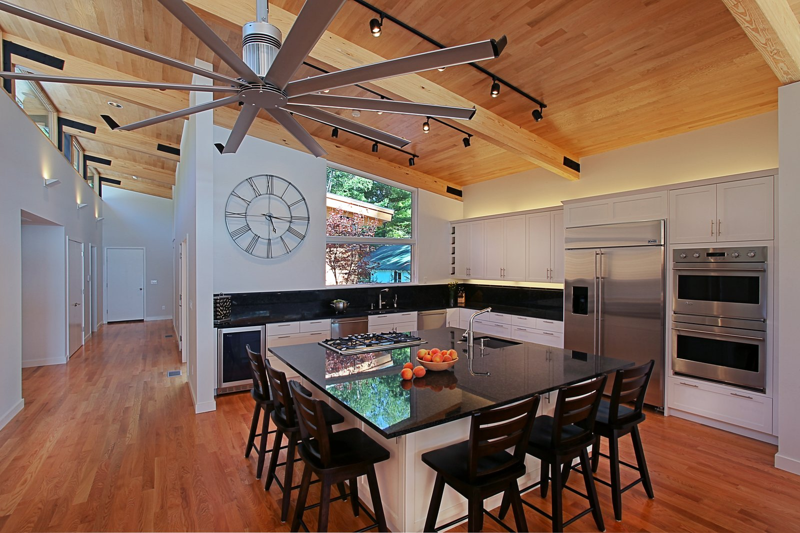 Kitchen with exposed beams and oak ceiling  Higgins Lake House by Jeff Jordan Architects