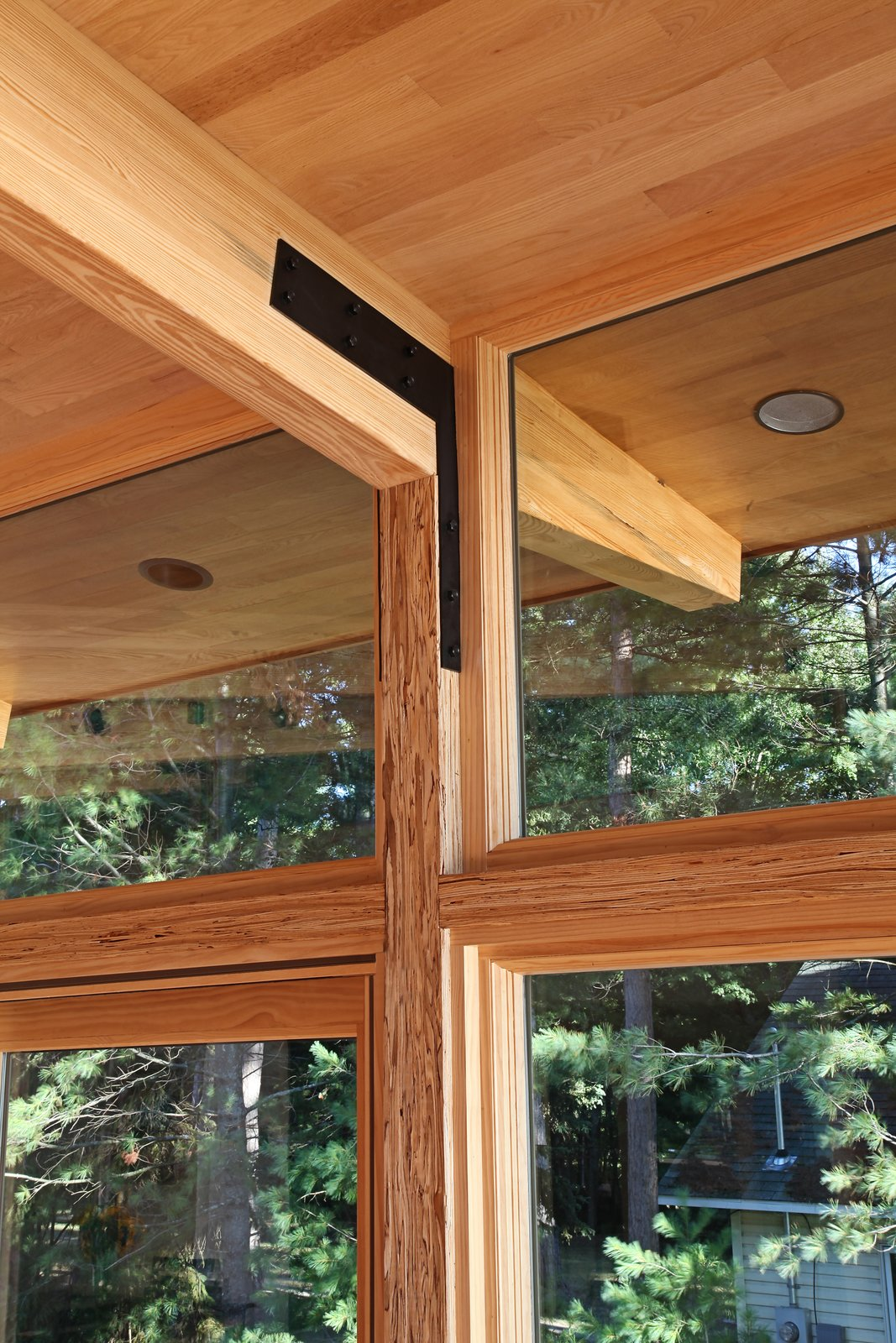 Structural detail showing post to column connection and custom bracket  Higgins Lake House by Jeff Jordan Architects