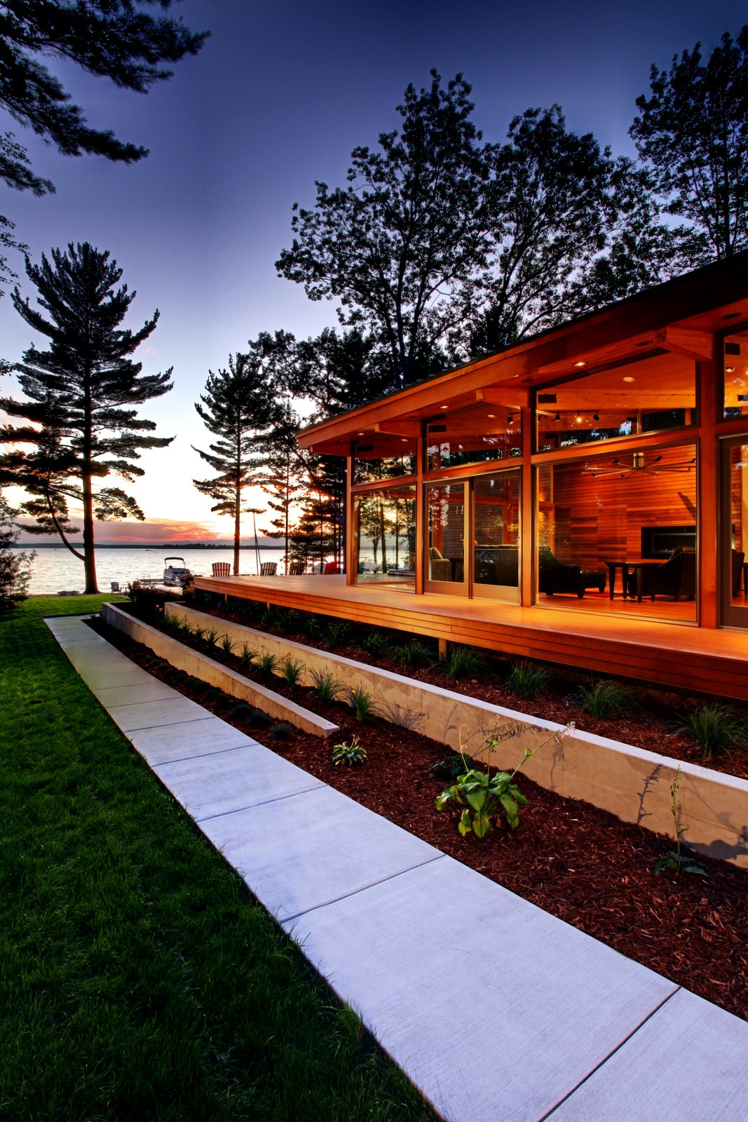 South side facade at dusk  Higgins Lake House by Jeff Jordan Architects