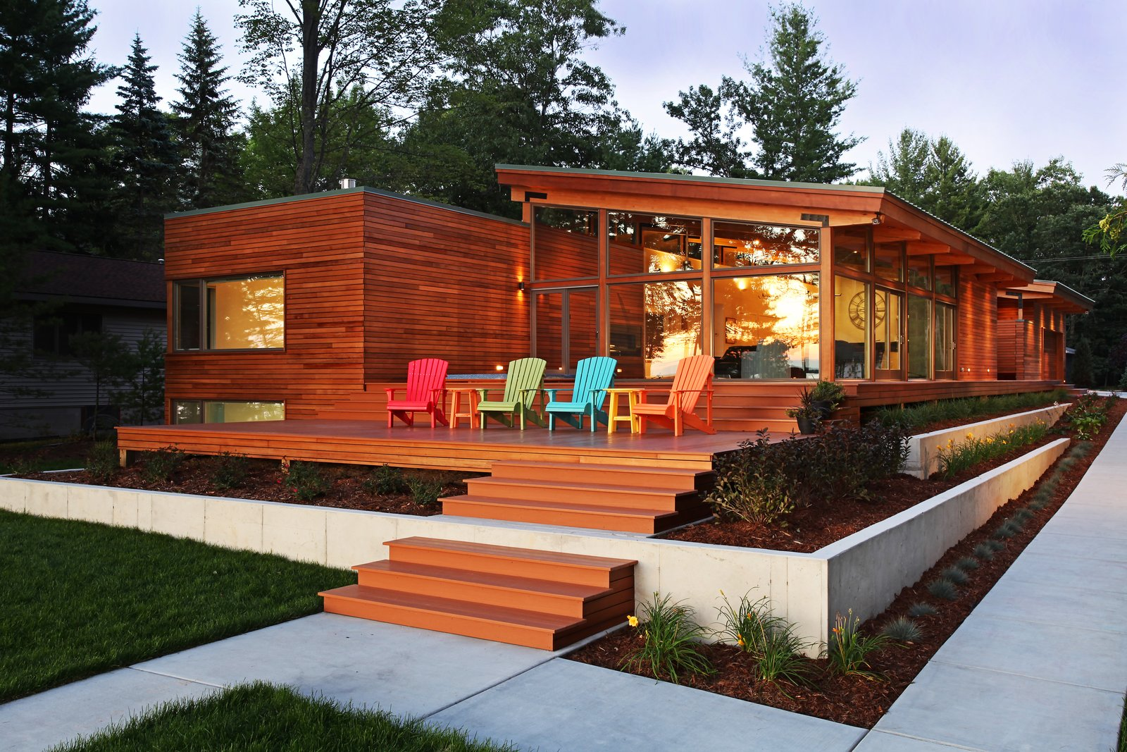 West side of house at sunset  Higgins Lake House by Jeff Jordan Architects