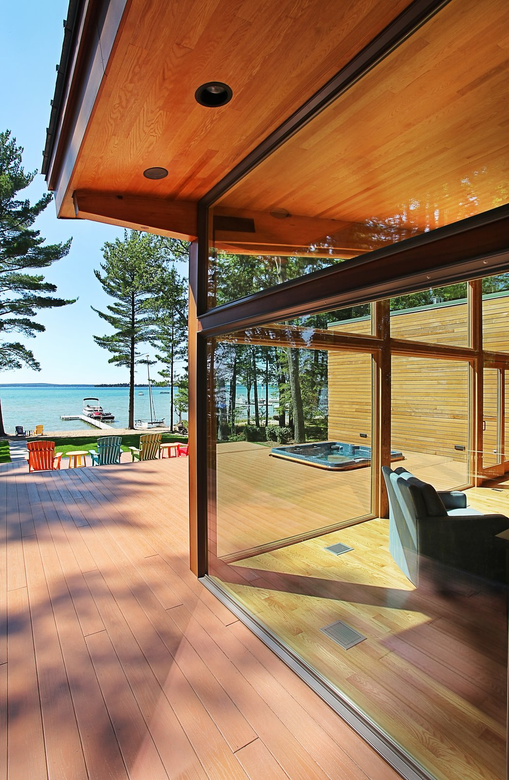 Southwest corner showing relationship between wrap around deck and interior  Higgins Lake House by Jeff Jordan Architects