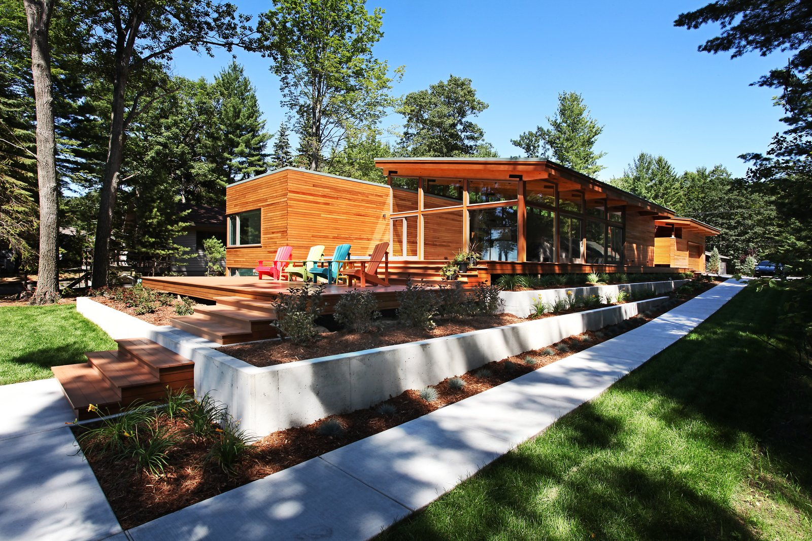 Southwest corner with stepped landscaping  Higgins Lake House by Jeff Jordan Architects