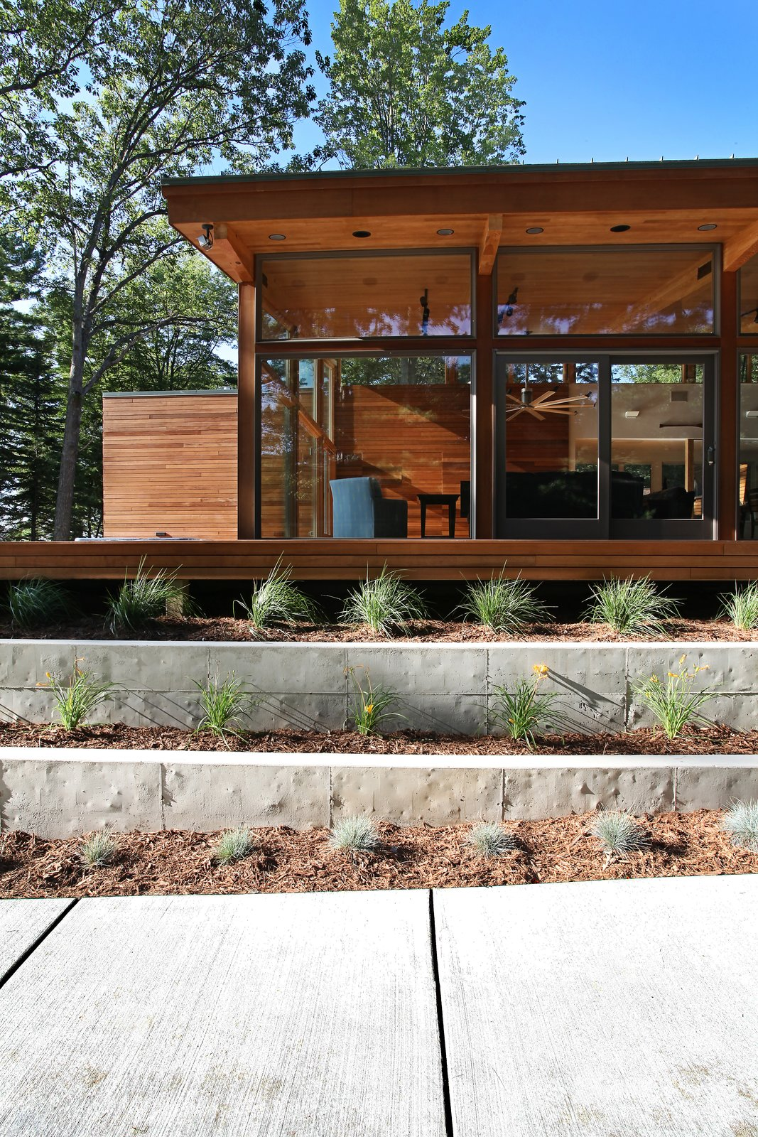 South side with concrete stepped retaining walls  Higgins Lake House by Jeff Jordan Architects