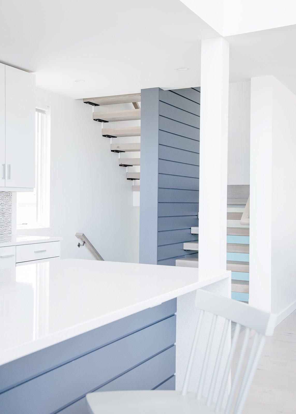 Kitchen, White Cabinet, Engineered Quartz Counter, Light Hardwood Floor, and Mosaic Tile Backsplashe Kitchen and stair  Sea Bright House by Jeff Jordan Architects