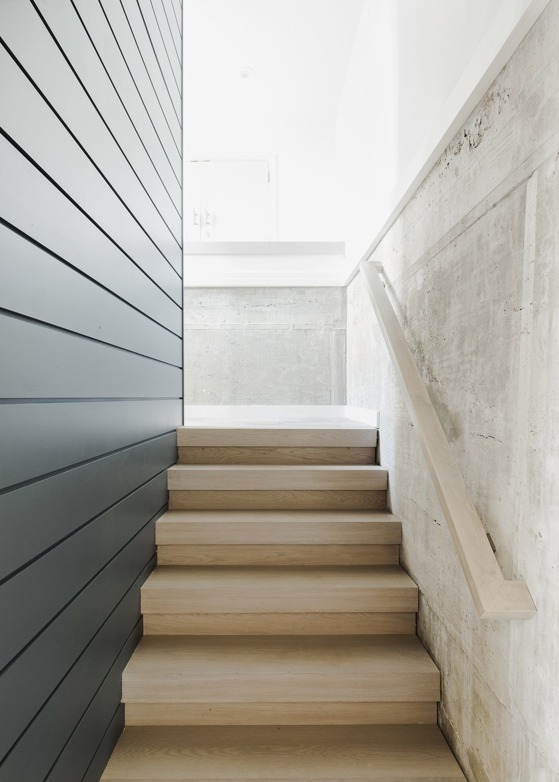 Staircase, Wood Tread, and Wood Railing Entry stair and concrete wall  Sea Bright House by Jeff Jordan Architects