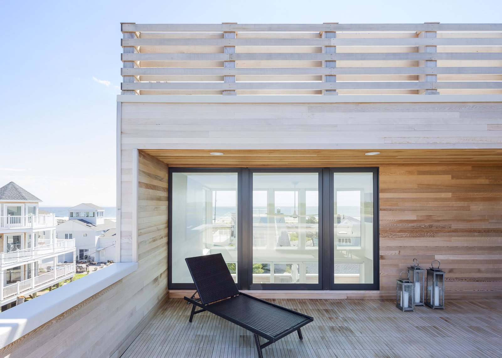 Outdoor, Horizontal Fences, Wall, Rooftop, Wood Patio, Porch, Deck, Decking Patio, Porch, Deck, and Wood Fences, Wall Riverside deck looking through house to ocean  Sea Bright House by Jeff Jordan Architects