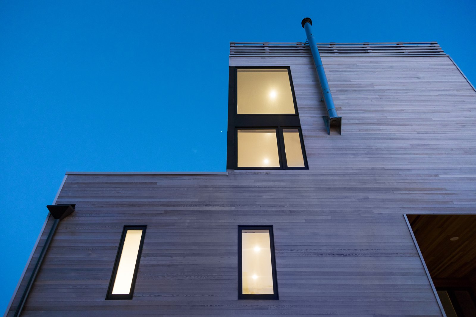 Outdoor Facade step at dusk  Sea Bright House by Jeff Jordan Architects