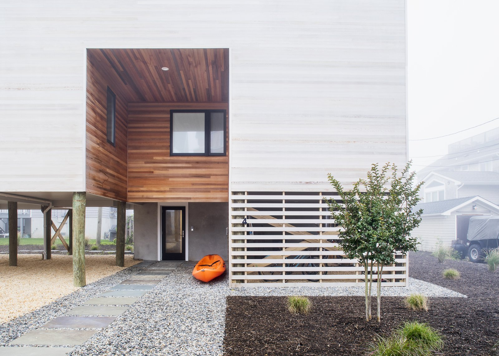 Exterior, House Building Type, Beach House Building Type, Flat RoofLine, and Wood Siding Material Entryway and screened gear enclosure  Sea Bright House by Jeff Jordan Architects